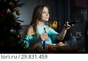 Woman watching TV alone at Christmas night. Стоковое фото, фотограф Яков Филимонов / Фотобанк Лори