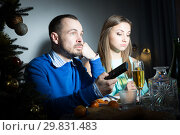 Купить «Unhappy couple celebrating New Year», фото № 29831483, снято 15 января 2019 г. (c) Яков Филимонов / Фотобанк Лори