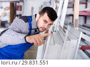 Купить «Professional labour with finished PVC profiles and windows at factory», фото № 29831551, снято 30 марта 2017 г. (c) Яков Филимонов / Фотобанк Лори