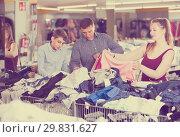 Buyers considering a choice of clothes. Стоковое фото, фотограф Яков Филимонов / Фотобанк Лори