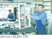 Купить «Workmen inspecting PVC manufacturing output in workshop», фото № 29831735, снято 30 марта 2017 г. (c) Яков Филимонов / Фотобанк Лори