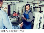 Купить «Smiling foreman is taking order from customer», фото № 29831743, снято 30 марта 2017 г. (c) Яков Филимонов / Фотобанк Лори