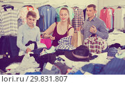 Купить «Mother,father and son choosing wear at the clearance sale shop», фото № 29831807, снято 13 апреля 2017 г. (c) Яков Филимонов / Фотобанк Лори