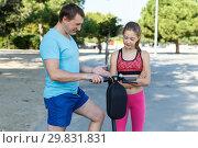 Купить «Father explaining daughter how driving kick scooter», фото № 29831831, снято 29 сентября 2018 г. (c) Яков Филимонов / Фотобанк Лори