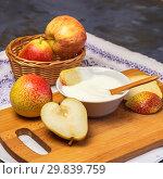 Купить «Food, healthy diet vitamin food. Milk product. Natural creamy yogurt in a bowl with fresh fruit pieces, juicy ripe pears and apples on the kitchen table», фото № 29839759, снято 27 мая 2018 г. (c) Светлана Евграфова / Фотобанк Лори