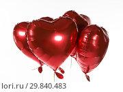 Купить «Valentine balloons against white background», фото № 29840483, снято 11 октября 2018 г. (c) Wavebreak Media / Фотобанк Лори