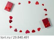 Купить «Valentine gifts and decorations on white background», фото № 29840491, снято 11 октября 2018 г. (c) Wavebreak Media / Фотобанк Лори
