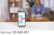 Купить «smartphone with text messages on screen on table», видеоролик № 29840951, снято 19 апреля 2019 г. (c) Syda Productions / Фотобанк Лори