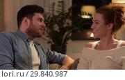 Купить «happy couple talking at home in evening», видеоролик № 29840987, снято 27 января 2019 г. (c) Syda Productions / Фотобанк Лори
