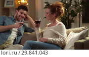 Купить «happy couple drinking red wine at home in evening», видеоролик № 29841043, снято 27 января 2019 г. (c) Syda Productions / Фотобанк Лори