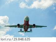 Купить «Airbus AirAsia flying overhead», фото № 29848635, снято 27 ноября 2016 г. (c) Игорь Жоров / Фотобанк Лори