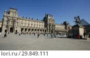 Купить «View of Louvre art gallery and Museum Paris, famous landmark in France», видеоролик № 29849111, снято 10 октября 2018 г. (c) Яков Филимонов / Фотобанк Лори