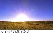 Купить «4K UHD mountain meadow timelapse at the summer. Clouds, trees, green grass and sun rays movement.», видеоролик № 29849243, снято 27 мая 2018 г. (c) Александр Маркин / Фотобанк Лори