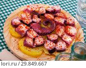 Купить «Pulpo a la gallega. Octopus galician dish», фото № 29849667, снято 19 марта 2019 г. (c) Яков Филимонов / Фотобанк Лори