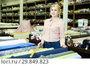 Купить «Saleswoman offering cloth in textile shop», фото № 29849823, снято 2 марта 2018 г. (c) Яков Филимонов / Фотобанк Лори