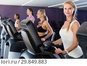 Купить «Slender athletic girls running on treadmill in fitness club», фото № 29849883, снято 26 июля 2017 г. (c) Яков Филимонов / Фотобанк Лори