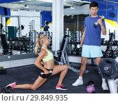 Купить «Couple during weightlifting workout», фото № 29849935, снято 16 июля 2018 г. (c) Яков Филимонов / Фотобанк Лори