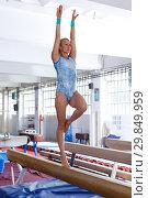 Купить «Sporty female acrobat in bodysuit practice new techniques at bars», фото № 29849959, снято 18 июля 2018 г. (c) Яков Филимонов / Фотобанк Лори