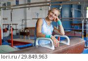 Купить «Positive mature woman acrobat in bodysuit exercising gymnastic action», фото № 29849963, снято 18 июля 2018 г. (c) Яков Филимонов / Фотобанк Лори