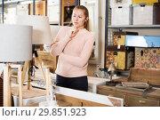 Купить «Female purchaser buying torchere», фото № 29851923, снято 15 ноября 2017 г. (c) Яков Филимонов / Фотобанк Лори