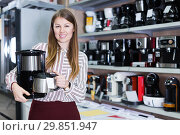 Купить «woman demonstrating coffee machine», фото № 29851947, снято 12 декабря 2017 г. (c) Яков Филимонов / Фотобанк Лори