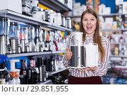 Купить «shopper in delight from new devices in store», фото № 29851955, снято 12 декабря 2017 г. (c) Яков Филимонов / Фотобанк Лори