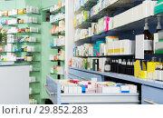 Купить «Medicines on shelves in pharmacy», фото № 29852283, снято 26 марта 2018 г. (c) Яков Филимонов / Фотобанк Лори