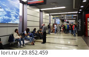 Купить «Moscow, Russia - June 6. 2018. people in Departure hall of airport Vnukovo», видеоролик № 29852459, снято 4 февраля 2019 г. (c) Володина Ольга / Фотобанк Лори