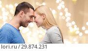 Купить «couple forehead to forehead over festive lights», фото № 29874231, снято 9 февраля 2014 г. (c) Syda Productions / Фотобанк Лори