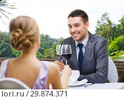 Купить «young couple with glasses of wine at restaurant», фото № 29874371, снято 9 марта 2014 г. (c) Syda Productions / Фотобанк Лори