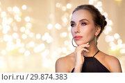 Купить «beautiful woman in black wearing diamond jewelry», фото № 29874383, снято 14 апреля 2016 г. (c) Syda Productions / Фотобанк Лори