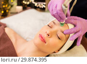 Купить «woman having microdermabrasion facial treatment», фото № 29874395, снято 26 января 2017 г. (c) Syda Productions / Фотобанк Лори