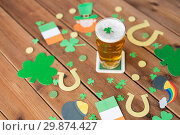 Купить «glass of beer and st patricks day party props», фото № 29874427, снято 31 января 2018 г. (c) Syda Productions / Фотобанк Лори