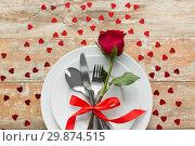 Купить «close up of red rose flower on set of dishes», фото № 29874515, снято 9 февраля 2018 г. (c) Syda Productions / Фотобанк Лори