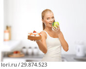 Купить «happy woman eating apple instead of cake», фото № 29874523, снято 23 марта 2013 г. (c) Syda Productions / Фотобанк Лори