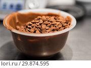 Купить «chocolate buttons in bowl at confectionery shop», фото № 29874595, снято 4 декабря 2018 г. (c) Syda Productions / Фотобанк Лори