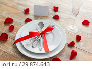 Купить «close up of table setting for valentines day», фото № 29874643, снято 9 февраля 2018 г. (c) Syda Productions / Фотобанк Лори