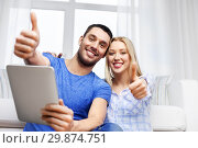 Купить «couple with tablet computer showing thumbs up», фото № 29874751, снято 9 февраля 2014 г. (c) Syda Productions / Фотобанк Лори