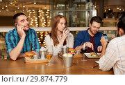 Купить «friends dining and drinking wine at restaurant», фото № 29874779, снято 8 ноября 2015 г. (c) Syda Productions / Фотобанк Лори