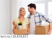Купить «happy couple with boxes moving to new home», фото № 29874811, снято 25 февраля 2016 г. (c) Syda Productions / Фотобанк Лори