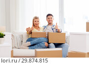 Купить «happy couple with boxes moving to new home», фото № 29874815, снято 25 февраля 2016 г. (c) Syda Productions / Фотобанк Лори