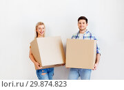 Купить «happy couple with boxes moving to new home», фото № 29874823, снято 25 февраля 2016 г. (c) Syda Productions / Фотобанк Лори