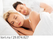 Купить «happy couple sleeping in bed at home», фото № 29874827, снято 25 февраля 2016 г. (c) Syda Productions / Фотобанк Лори