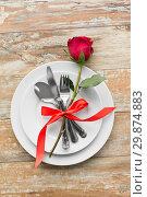 Купить «red rose on set of dishes with cutlery on table», фото № 29874883, снято 9 февраля 2018 г. (c) Syda Productions / Фотобанк Лори