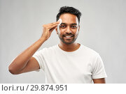 Купить «smiling indian man cleaning face with cotton pad», фото № 29874951, снято 27 октября 2018 г. (c) Syda Productions / Фотобанк Лори