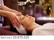 Купить «woman having face and head massage at spa», фото № 29875035, снято 26 января 2017 г. (c) Syda Productions / Фотобанк Лори