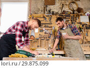 Купить «carpenters working and drinking coffee at workshop», фото № 29875099, снято 14 мая 2016 г. (c) Syda Productions / Фотобанк Лори