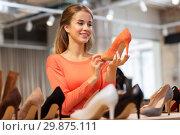 Купить «happy young woman choosing shoes at store», фото № 29875111, снято 22 сентября 2017 г. (c) Syda Productions / Фотобанк Лори