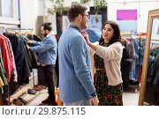 Купить «couple choosing clothes at vintage clothing store», фото № 29875115, снято 30 ноября 2017 г. (c) Syda Productions / Фотобанк Лори