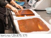 Купить «confectioner makes chocolate dessert at sweet-shop», фото № 29875171, снято 4 декабря 2018 г. (c) Syda Productions / Фотобанк Лори